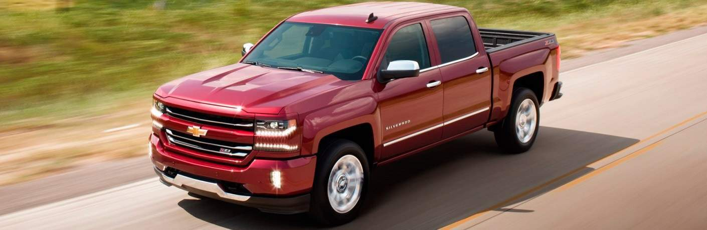 red 2017 Chevrolet Silverado 1500 driving on open road