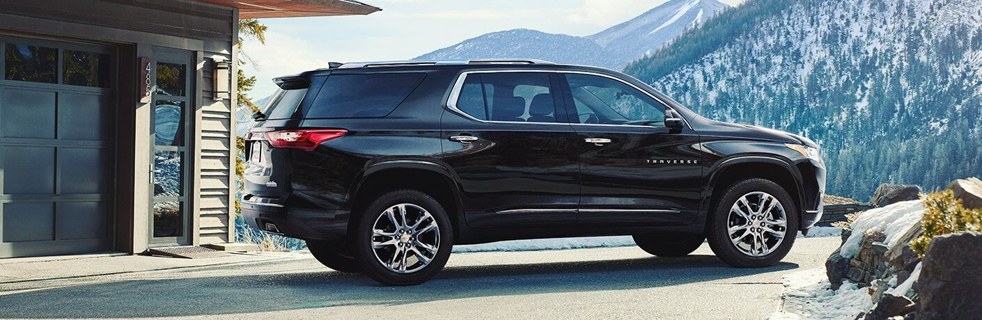 Black 2018 Chevy Traverse parked outside of home