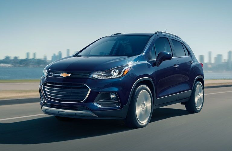 Blue 2019 Chevy Trax driving along highway
