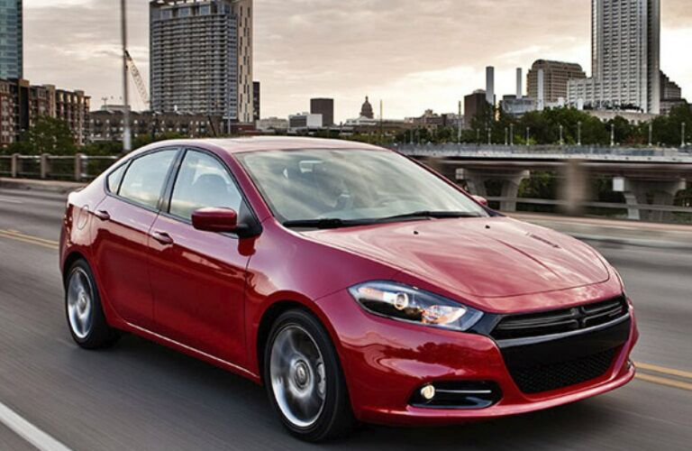 2014 Dodge Dart driving on bridge