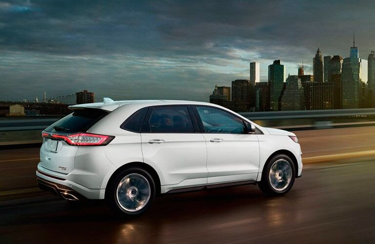 White 2018 Ford Edge driving at night