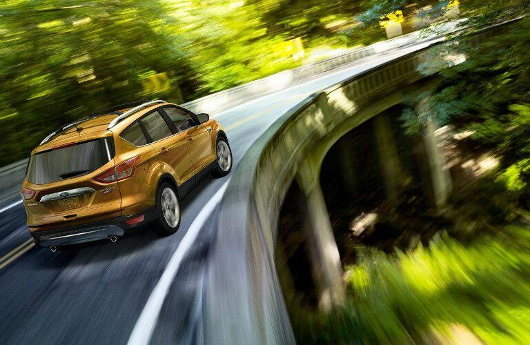 Yellow 2016 Ford Escape making a right turn
