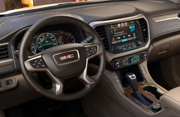 steering wheel and infotainment system in the 2017 GMC Acadia