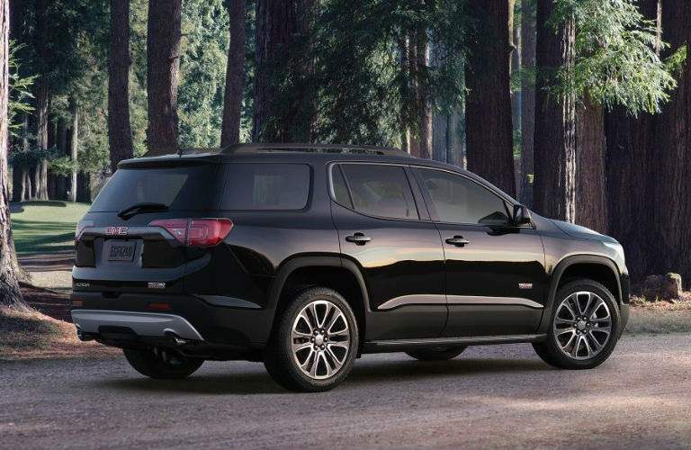 black 2017 GMC Acadia parked near forest