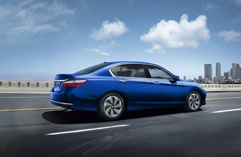 blue 2016 Honda Accord driving over bridge