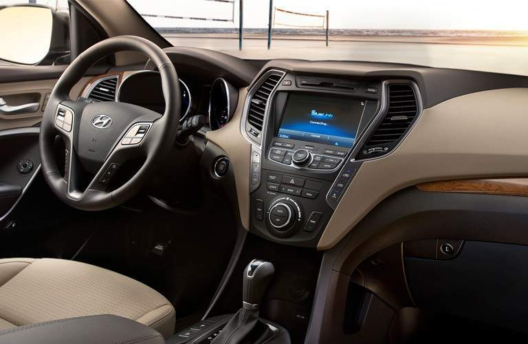 steering wheel and infotainment system in a 2017 Hyundai Santa Fe