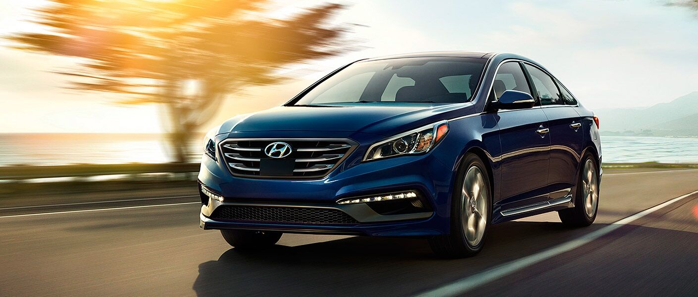Blue 2017 Hyundai Sonata driving along coastline