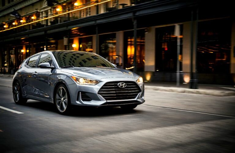 Gray 2019 Hyundai Veloster driving down city street