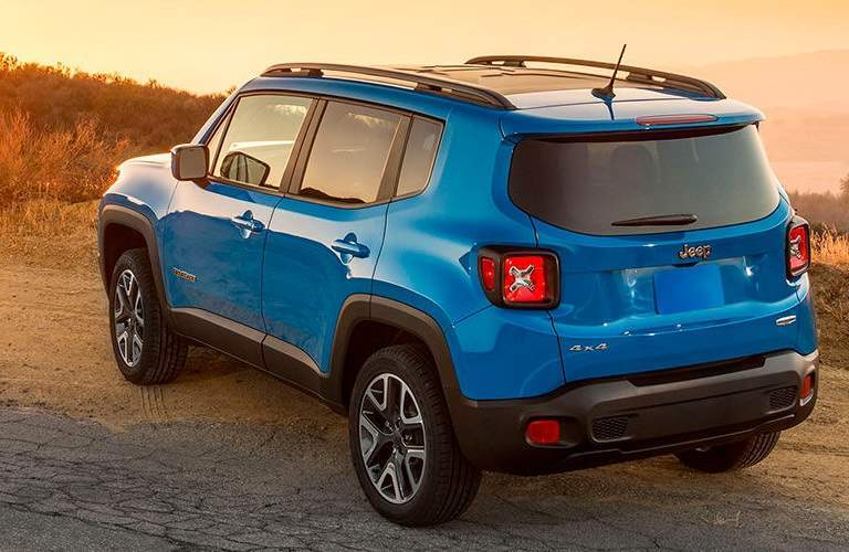 blue 2016 Jeep Renegade parked alongside road