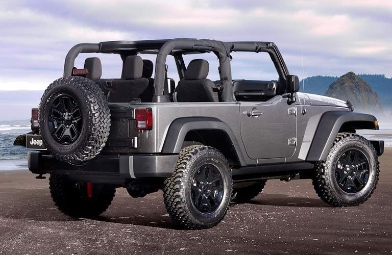 2016 gray Jeep Wrangler parked on beach