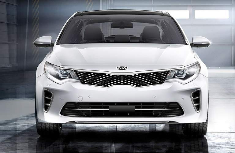 front view of a white 2017 Kia Optima parked in a garage