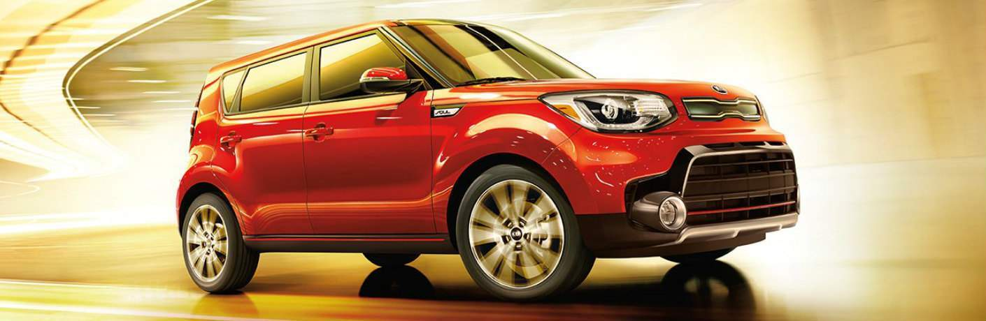 red 2017 Kia Soul driving through tunnel