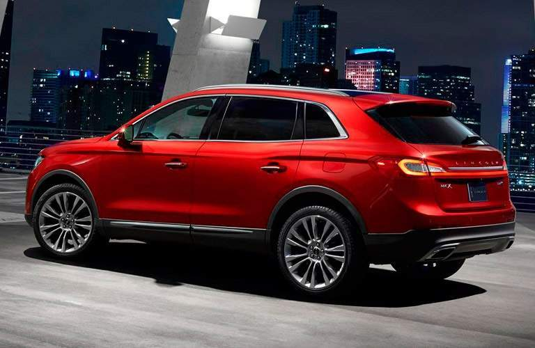 red 2016 Lincoln MKX driving at night