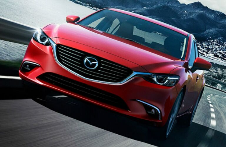 Red 2016 Mazda6 driving along highway