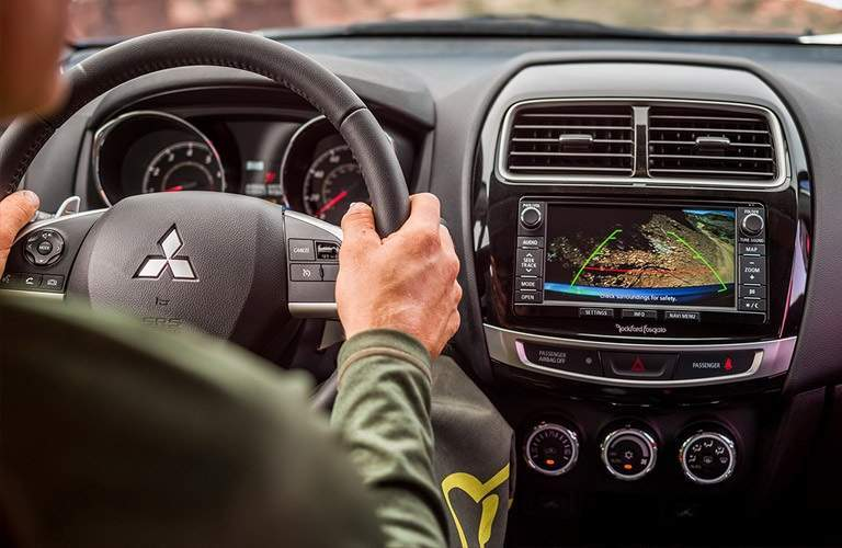 man driving the 2016 Mitsubishi Outlander Sport