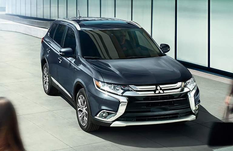 blue 2016 Mitsubishi Outlander parked in the city