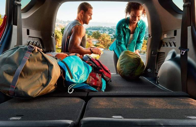 active couple loading up the back of the 2017 Toyota RAV4