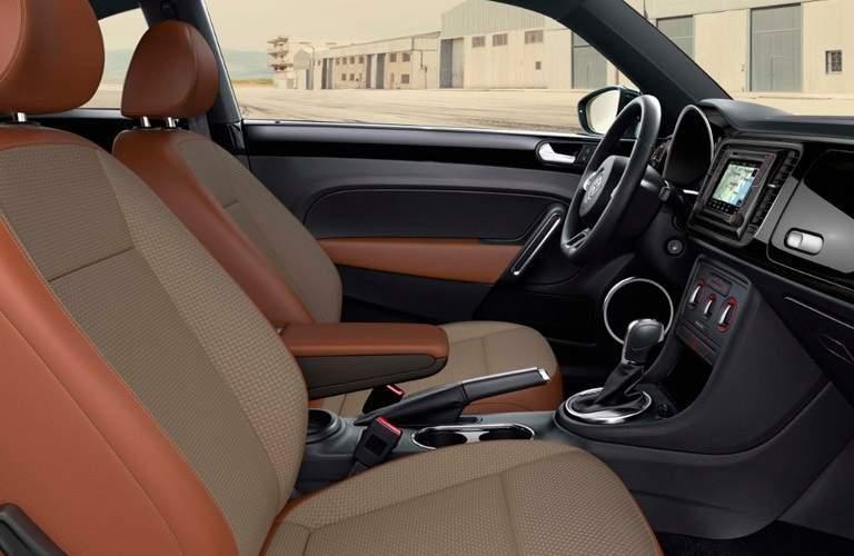 Interior front seats of a 2017 Volkswagen Beetle