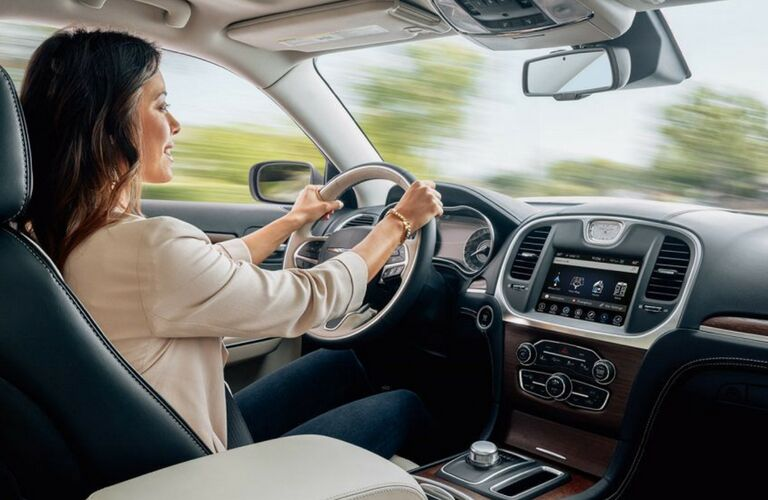 2018 Chrysler 300 woman driving front seat