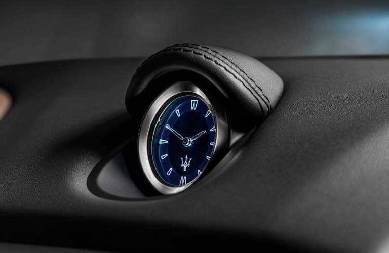 interior analog clock inside the 2018 Maserati Ghibli