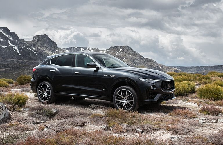 Profile view of 2019 Maserati Levante in front of mountains