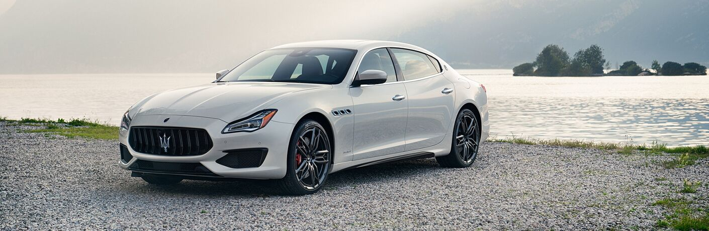 2019 Maserati Quattroporte white parked by a waterfront
