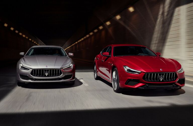 Two 2019 Maserati Ghibli driving out of tunnel