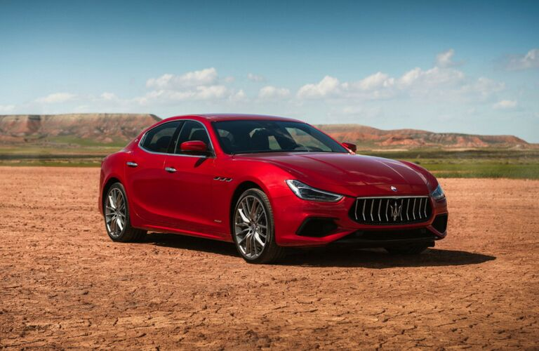 2019 Maserati Ghibli red on dry dirt road