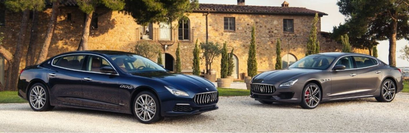 2 2020 Maserati Quattroporte exteriors front fascia driver side front fascia passenger side in front of stone building