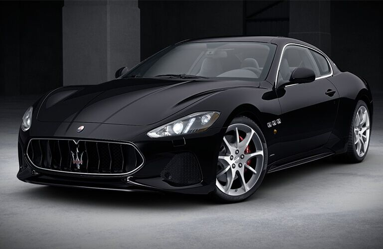 Black 2019 Maserati GranTurismo deep underground on display.