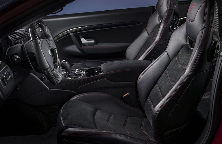 Side view of swanky interior front seats inside a 2019 Maserati GranTurismo.