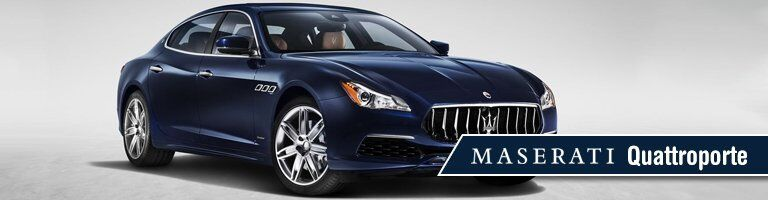 blue 2019 Maserati Quattroporte with banner in bottom right corner