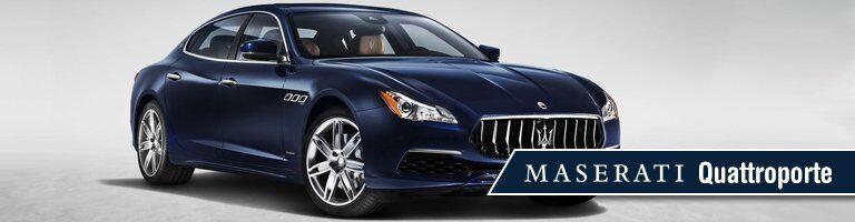 blue 2019 Maserati Quattroporte with banner in bottom right corner