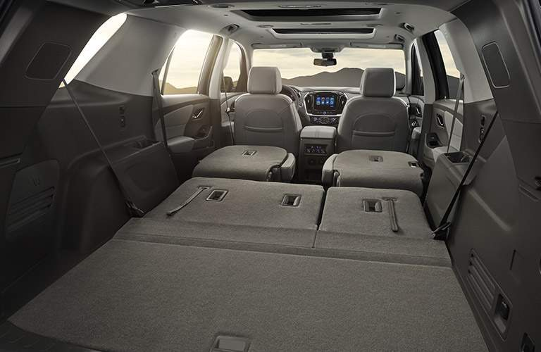 rear cargo space of 2018 chevy traverse with rear seats folded down