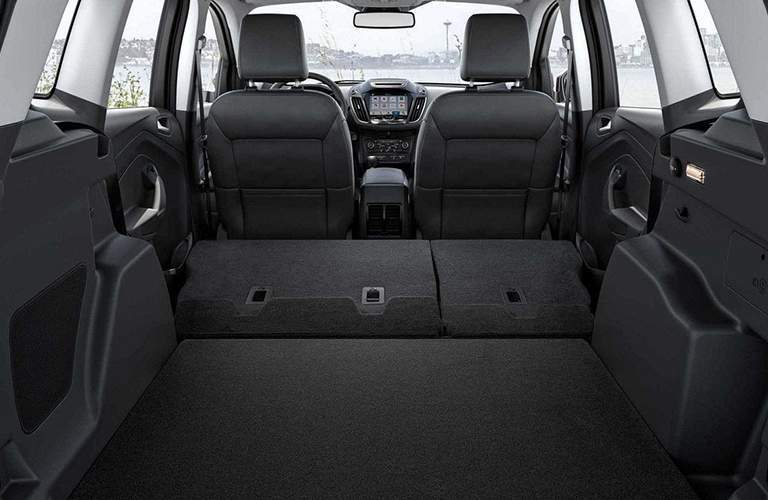 rear interior cargo space of 2018 ford escape with rear seats folded down