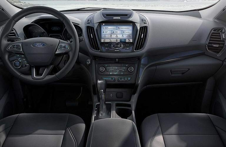 front interior of 2018 ford escape including steering wheel, dashboard and center infotainment system