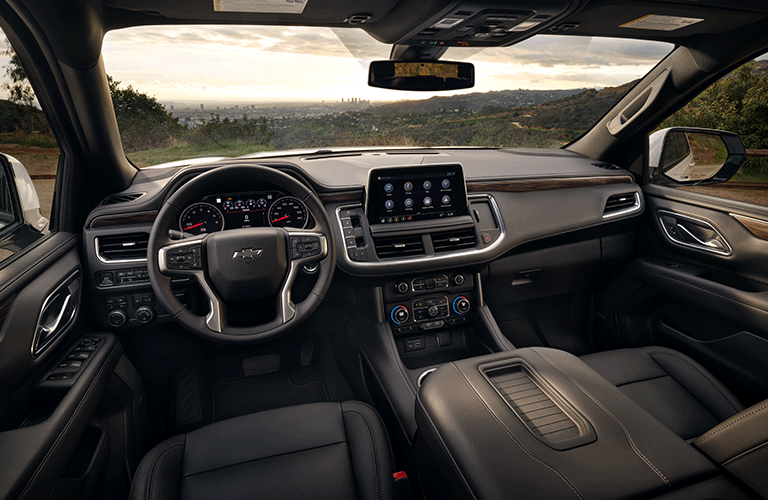 Interior view of the front seating area inside a 2021 Chevrolet Tahoe