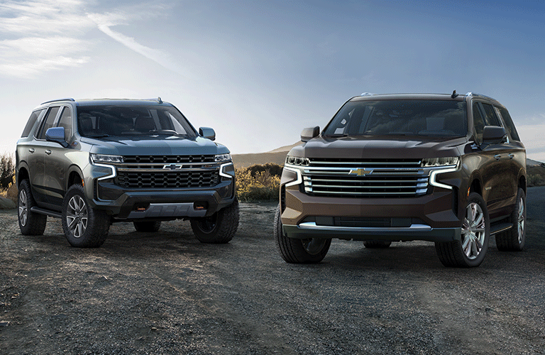 Exterior view of a gray 2021 Chevrolet Tahoe and a bronze 2021 Chevrolet Tahoe