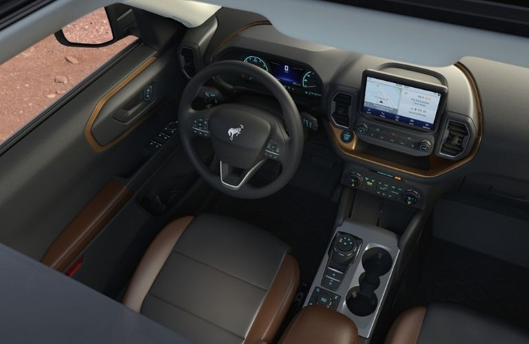 Interior view of the front seating area inside a 2021 Ford Bronco Sport