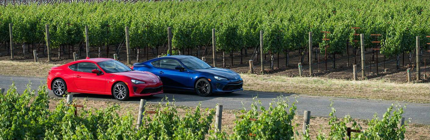 Two 2018 Toyota 86 Vehicles Driving by a Vineyard
