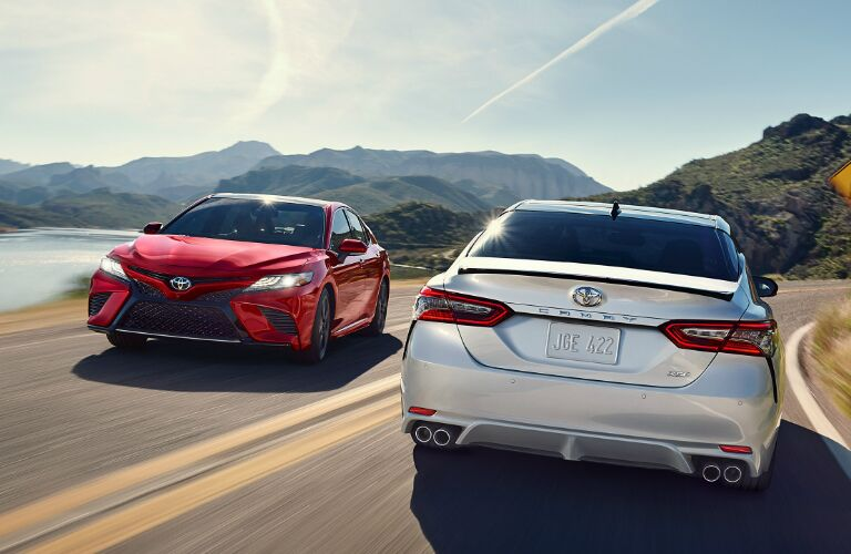 Two 2019 Toyota Camry Vehicles Passing By Each Other on a Mountain Road