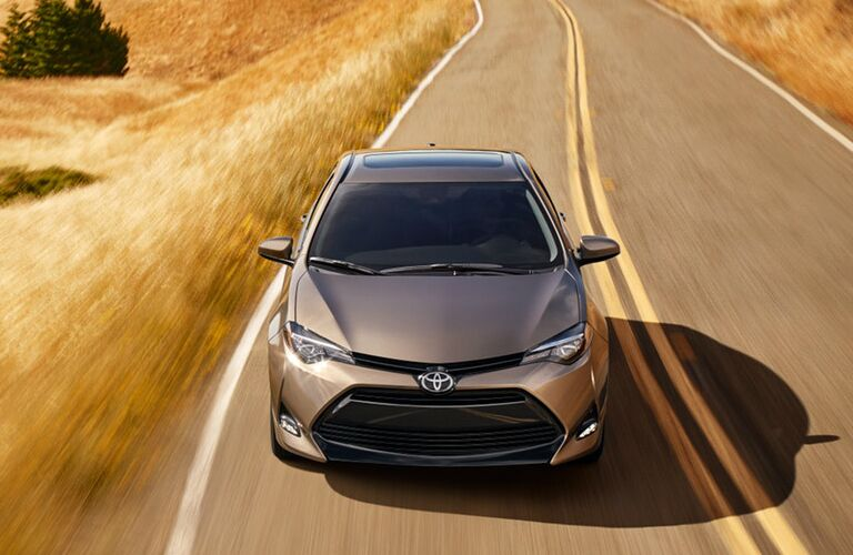 2019 Toyota Corolla Driving by a Prairie