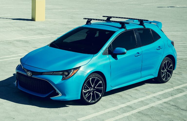 Blue 2019 Toyota Corolla Hatchback in a Parking Lot