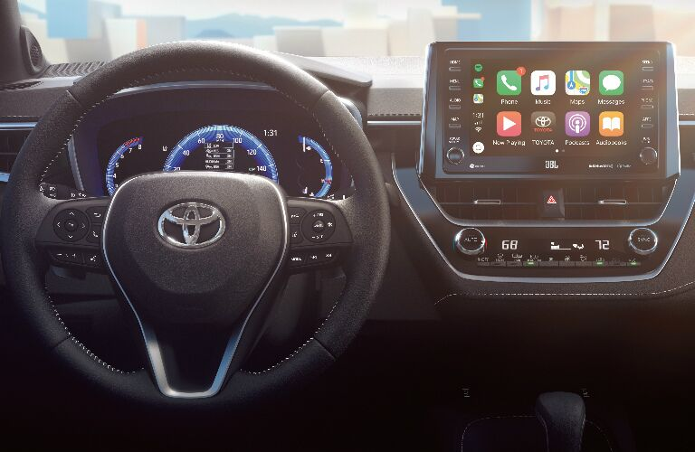 Steering Wheel, Gauges, and Touchscreen of 2019 Toyota Corolla Hatchback