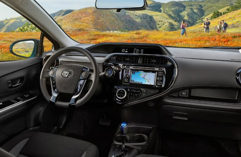 Dashboard and Dark Grey Front Seats in 2019 Toyota Prius c