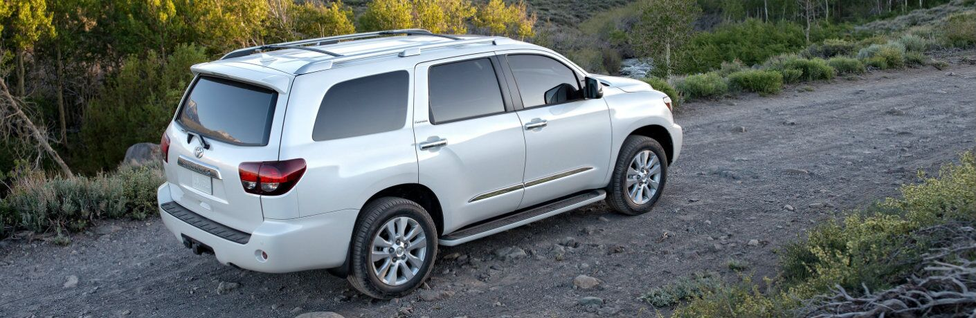 White 2019 Toyota Sequoia Driving on a Gravel Road