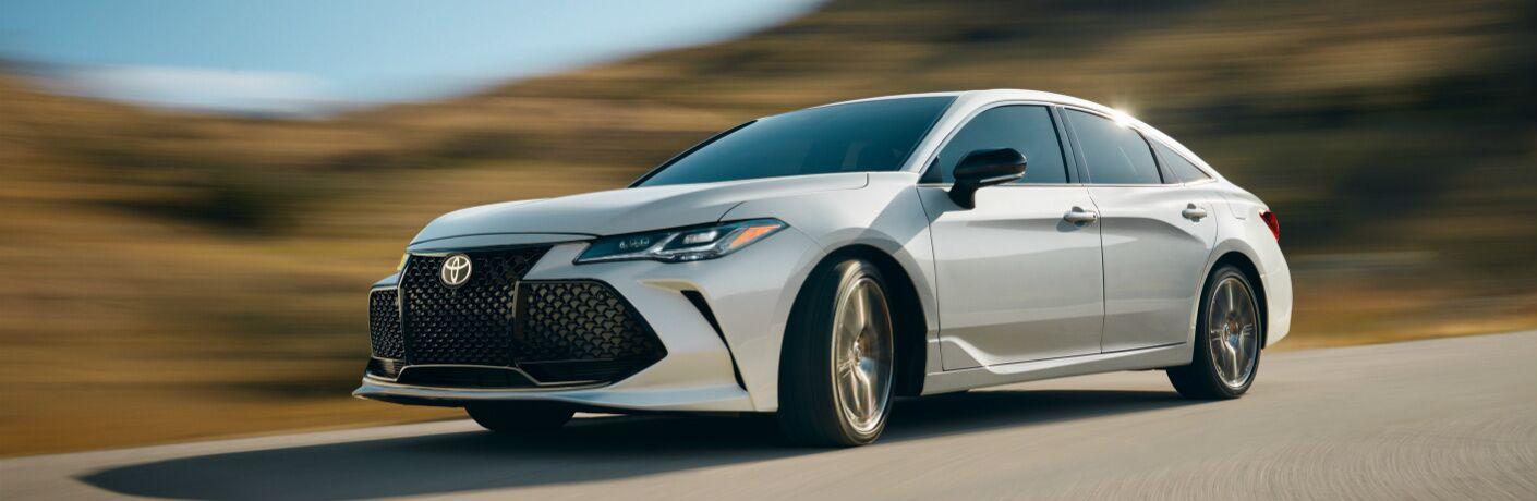 Side View of White 2019 Toyota Avalon Hybrid
