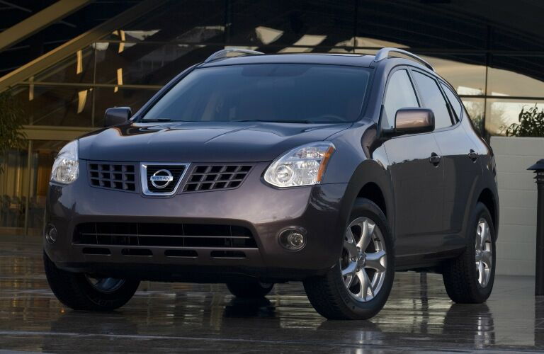 2008 Nissan Rogue parked on wet surface