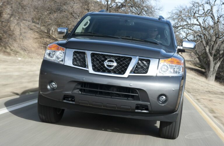 2012 Nissan Armada driving on highway exterior front view