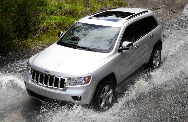 Silver Jeep Grand Cherokee Driving Through Water